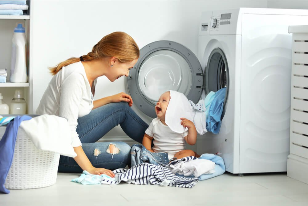 washing machine used by mother and child