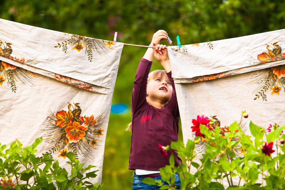 young girl using a washing line