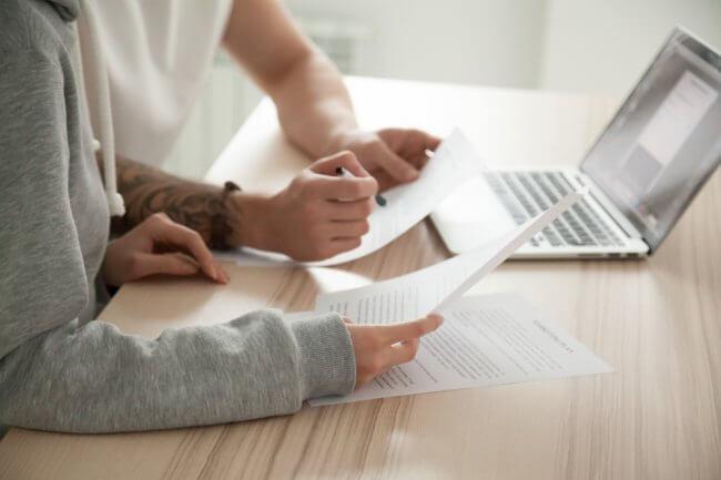 Couple reading through contract