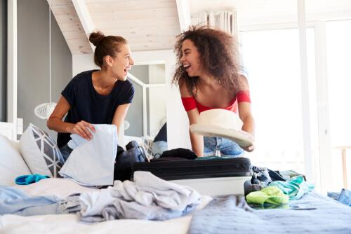 Two women packing bags
