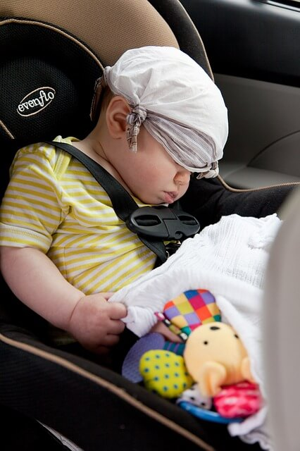 Young child in the backseat of a car