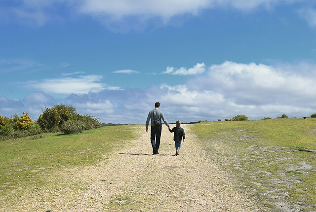 father and son as a family walking