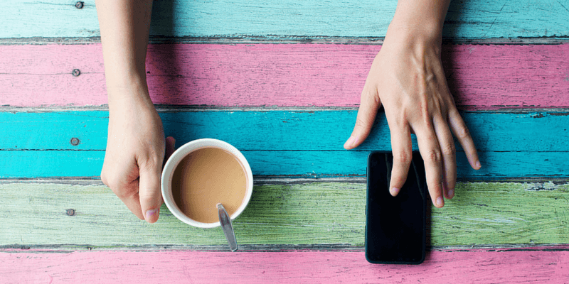 phone usage and coffee cup