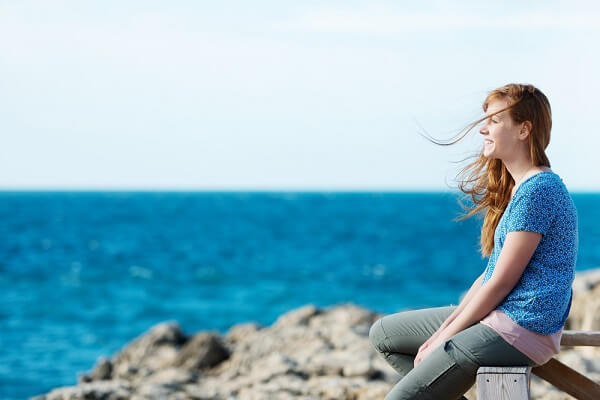women sitting by the beach