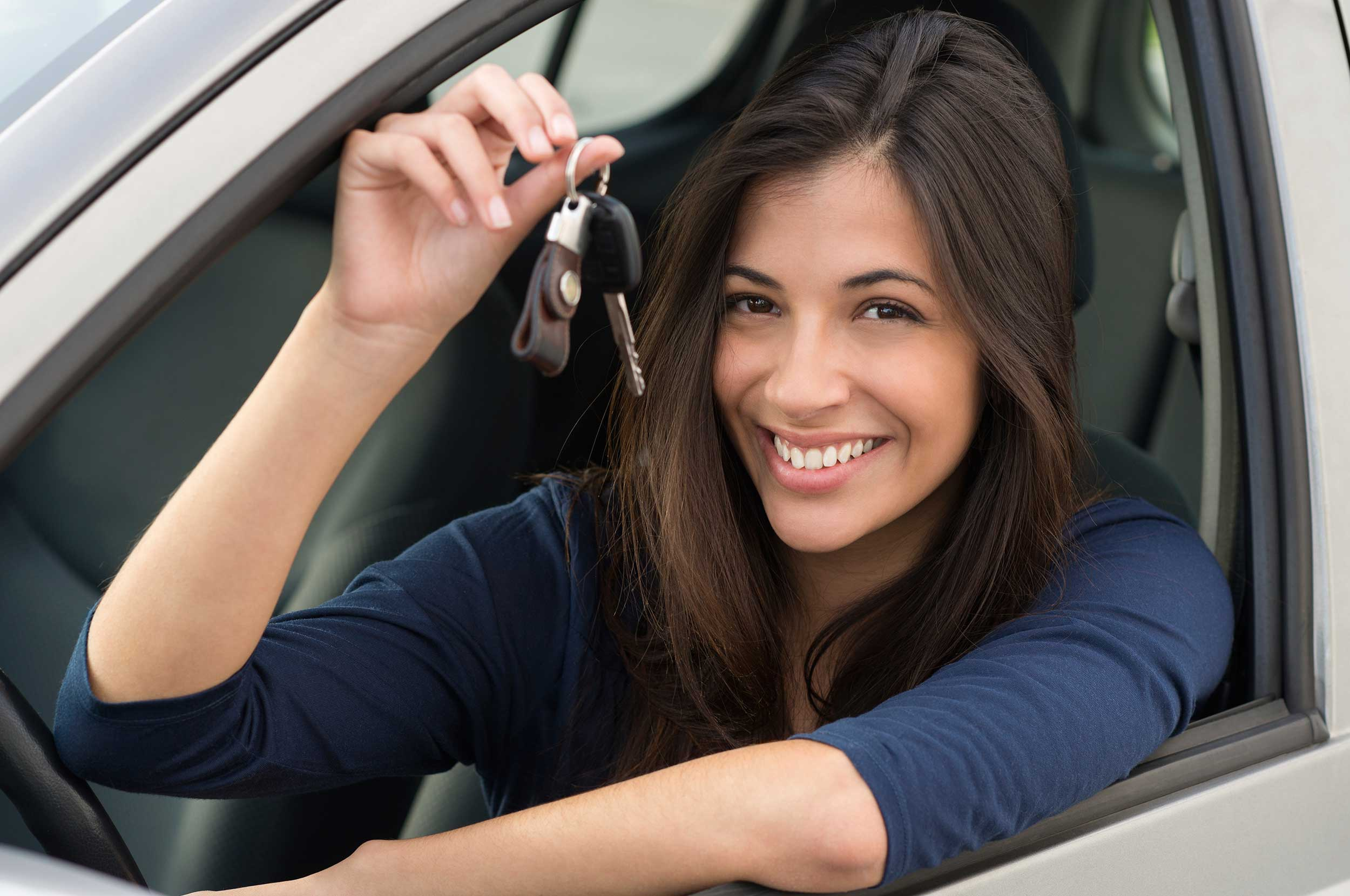 20-Year-Old-Girl-In-Car-Holding-Up-Keys