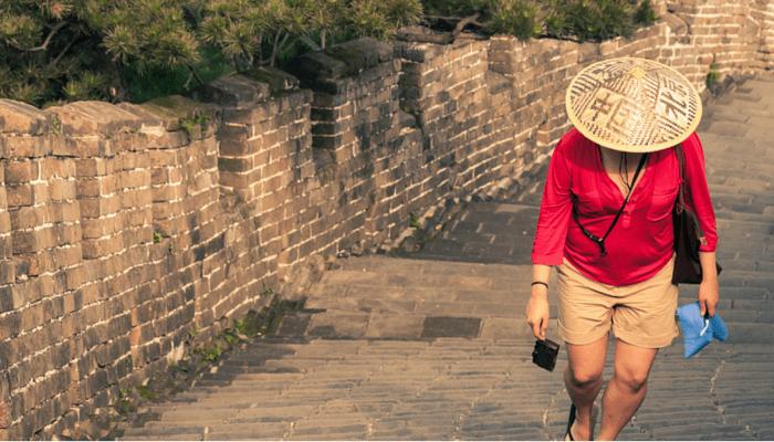 solo women walking through the great wall of china