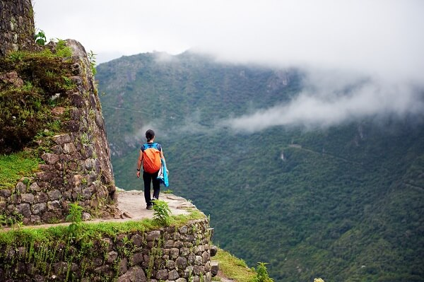 girl walking near the end of a trail in south america