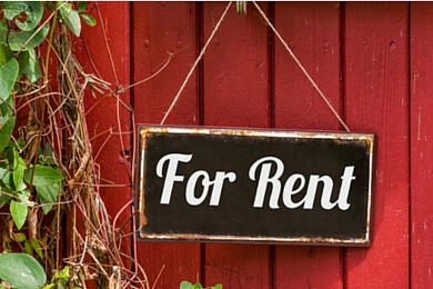 for rent sign on a red wooden door