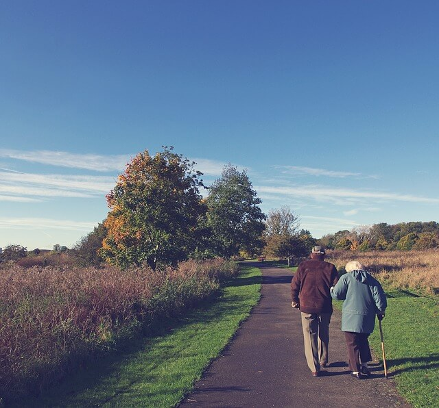 old couple walking down the road