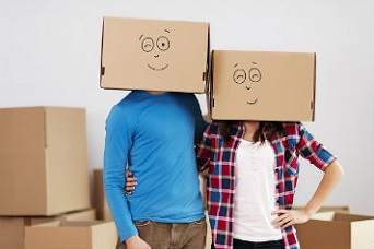 cardboard boxes wren as a face mask by a couple