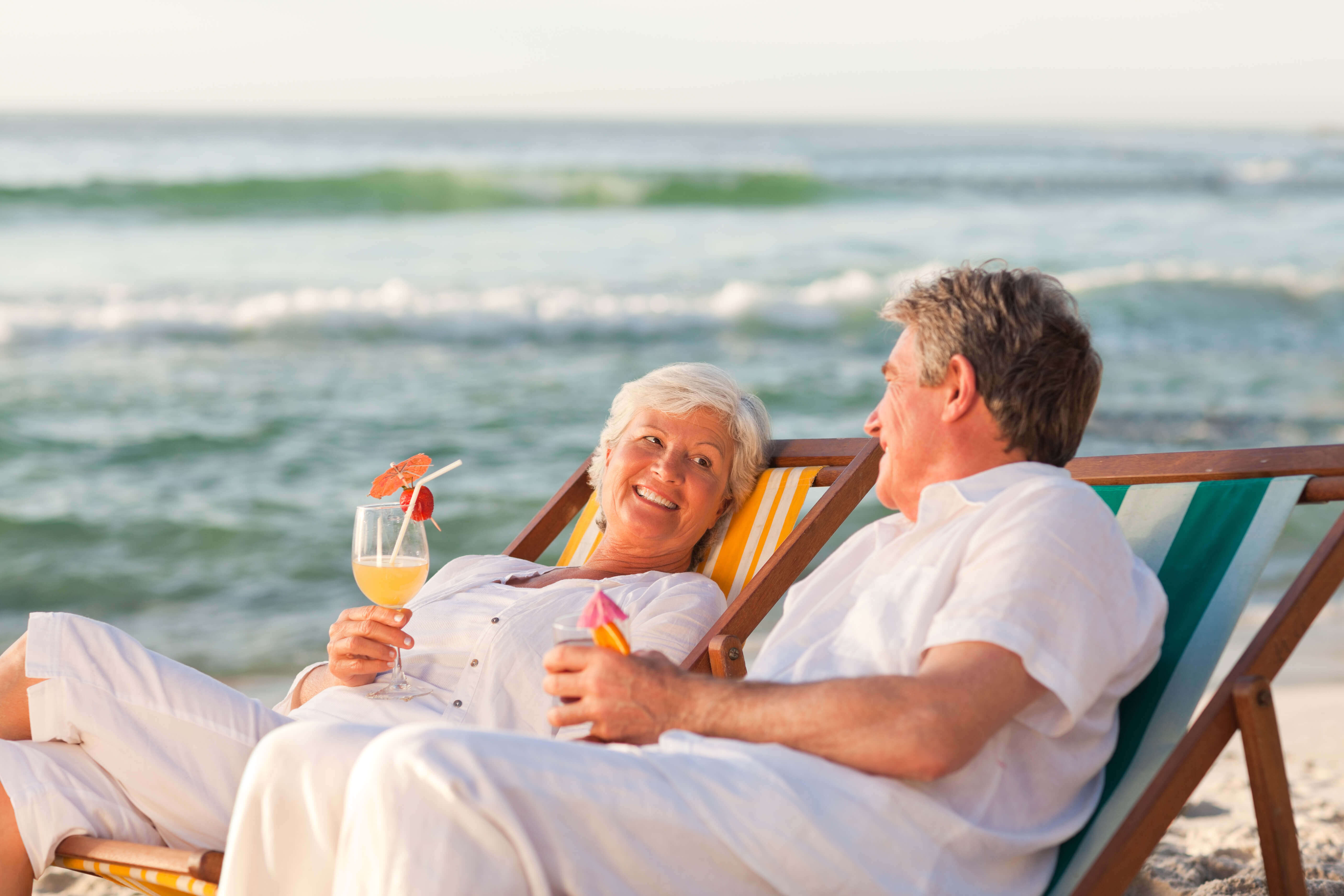 old men and women sitting on the beach