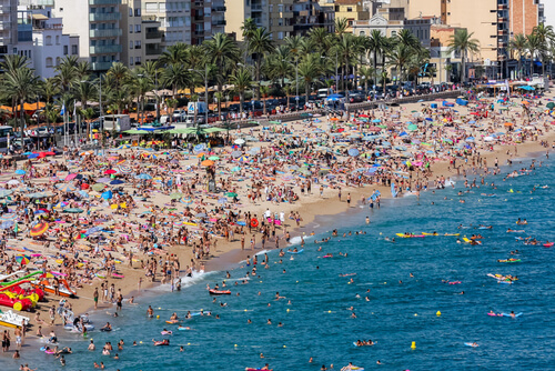 Beach overcrowded with tourists in Spain