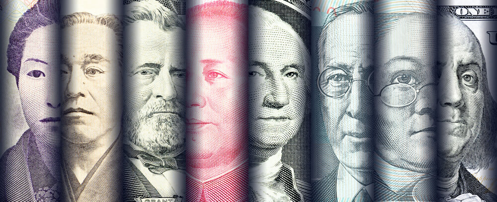 faces of famous leader on banknotes