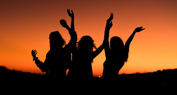 Friends celebrating at sundown