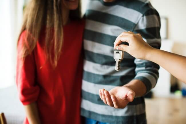 Couple receiving house keys