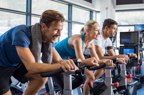 people cycling at the gym