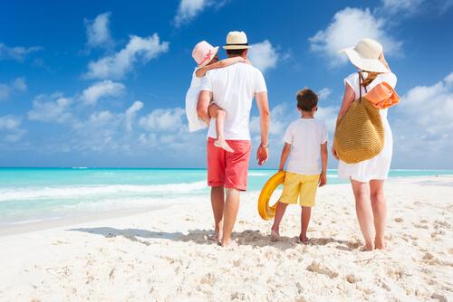 Family enjoying a beach holiday.