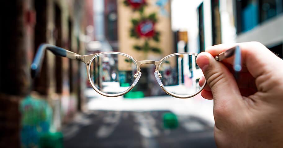 Holding up glasses