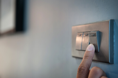 Close up of person switching on power