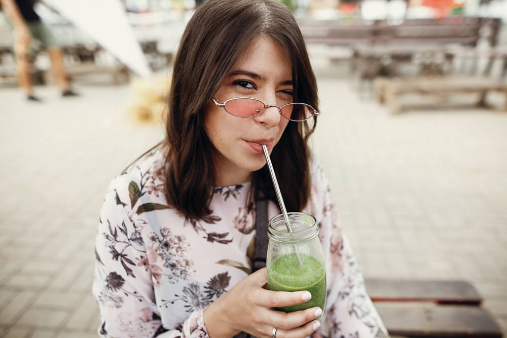 Woman drinking through a straw