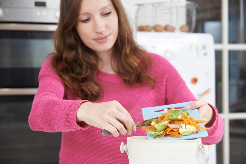 Women composting food scraps