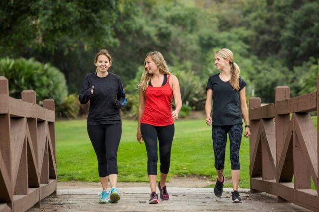 three women out walking, dressed in exercise clothing