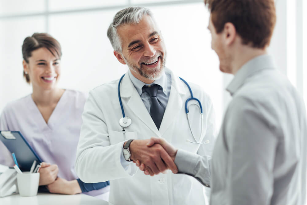 A doctor discussing Medicare cover