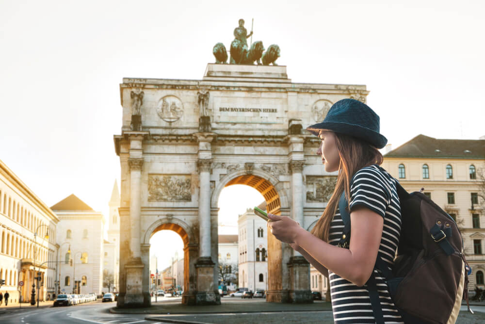 a female tourist exploring the Siegestor arch in Munich