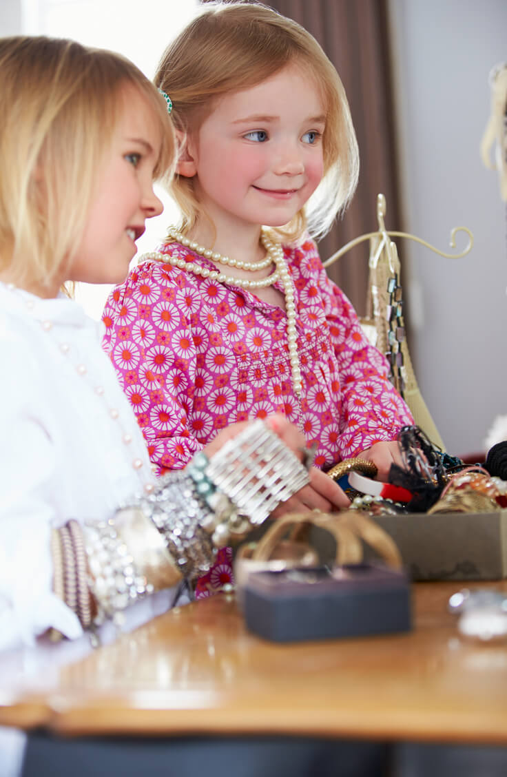 Young girls playing with jewellery