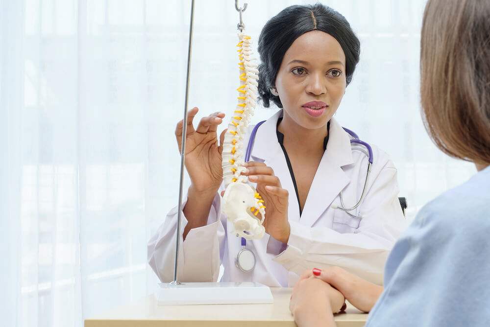 chiropractic doctor with patient