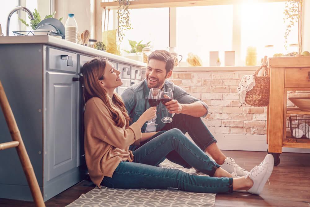 couple sitting on kitchen floor