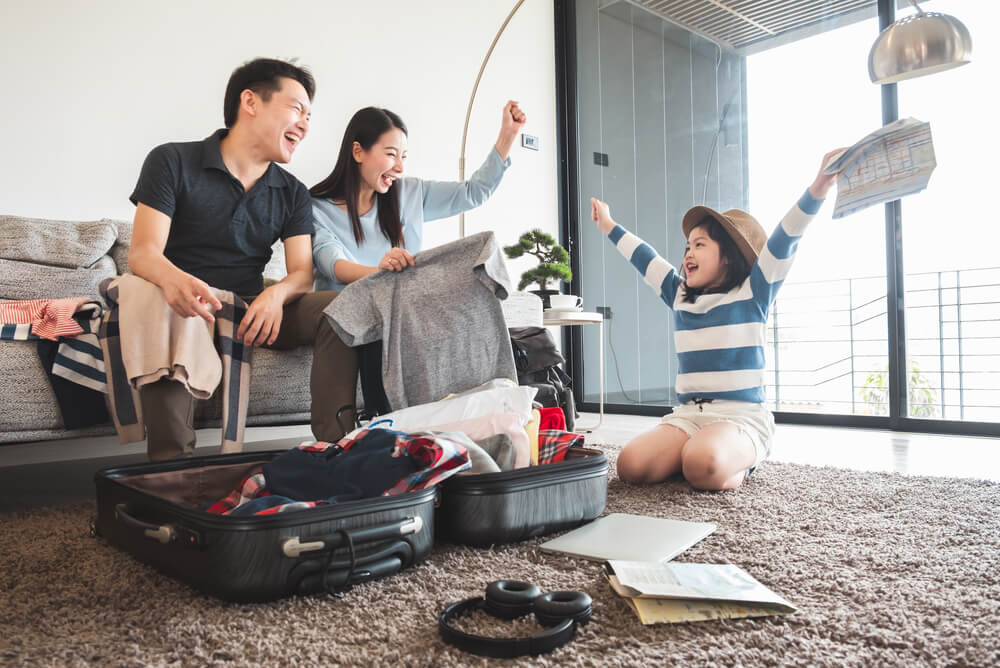 family packing luggage for an overseas holiday