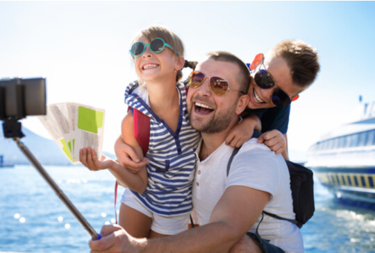 father and children on a cruise