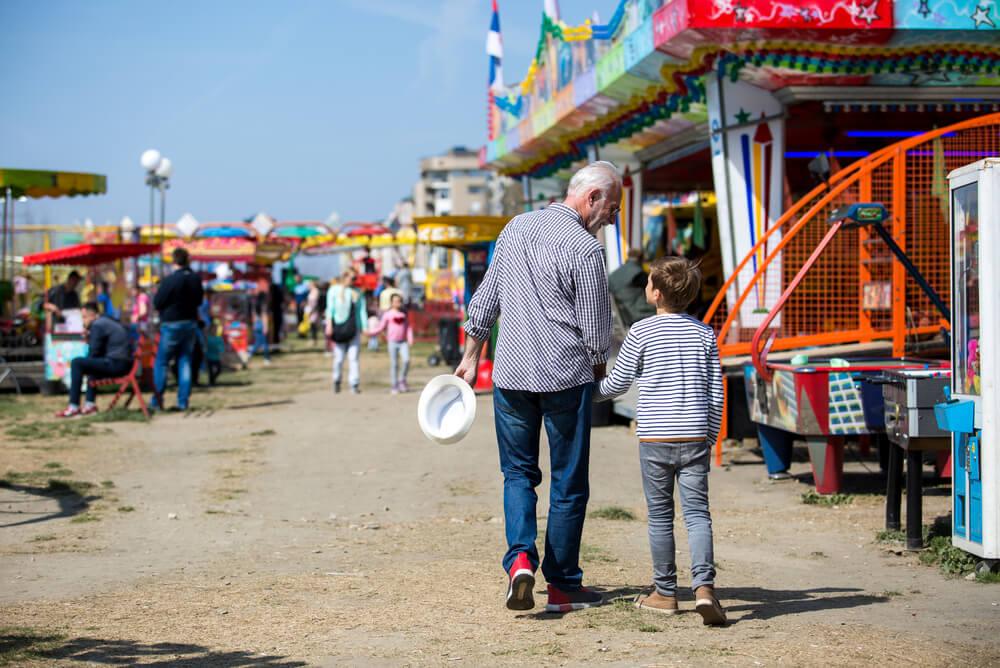 Grandfather and grandson at a local fair.