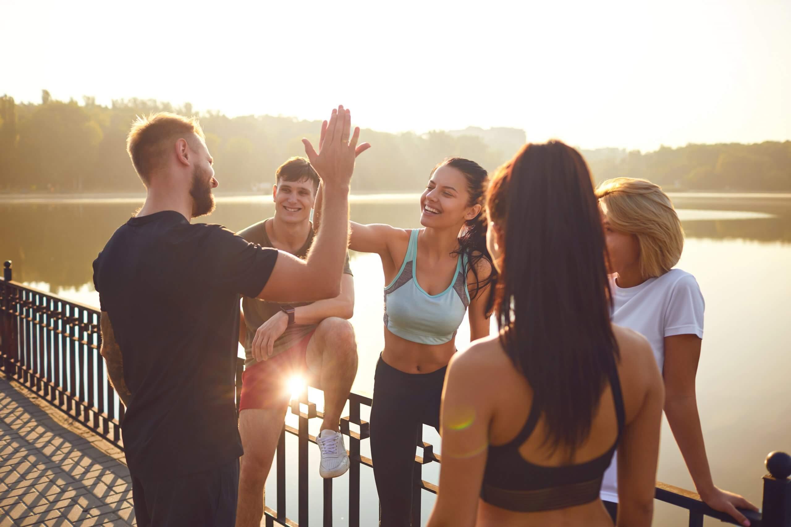 group-yoga-high-fiving