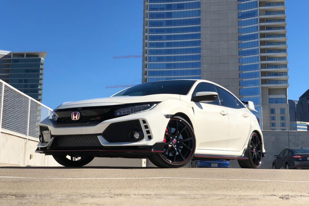 A Honda in a rooftop carpark.