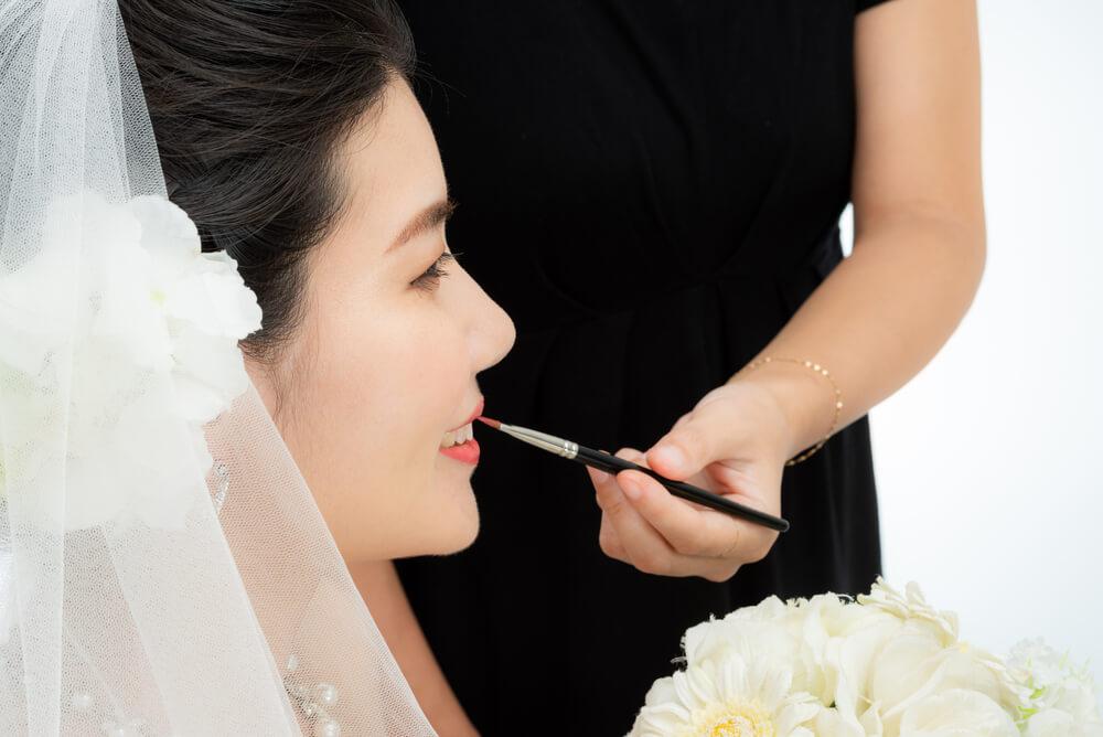 Makeup artist doing bridal makeup