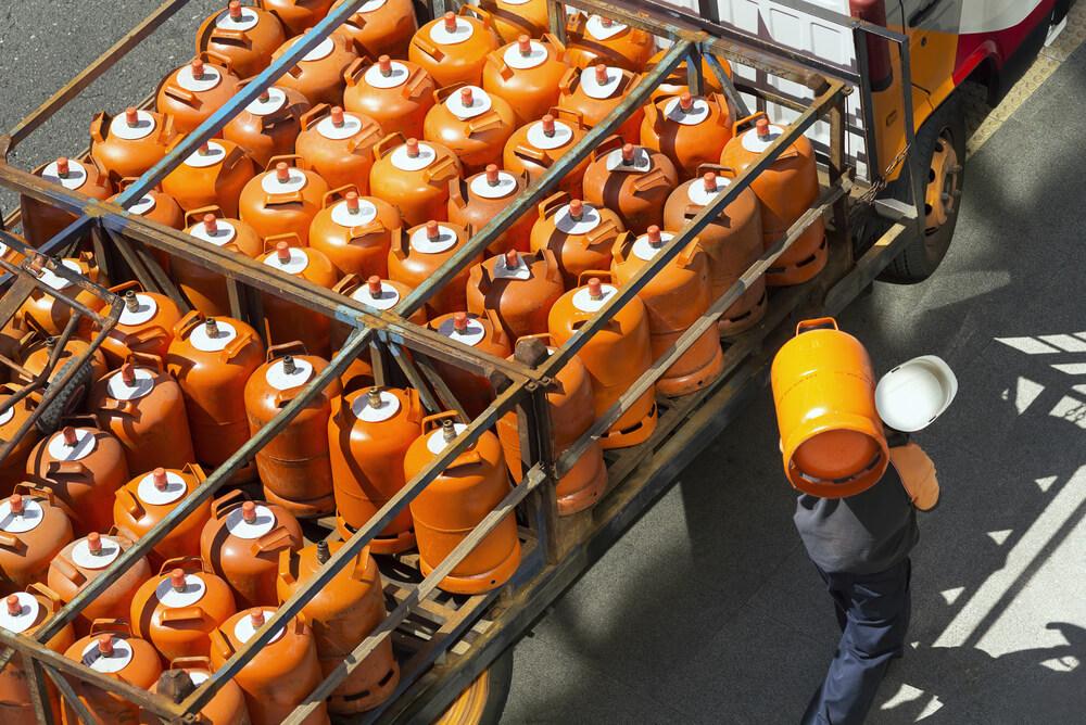 man delivering lpg cylinders