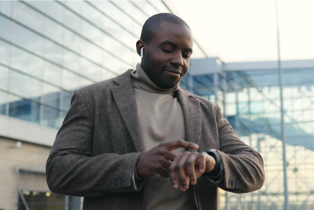 A man looking at his watch.
