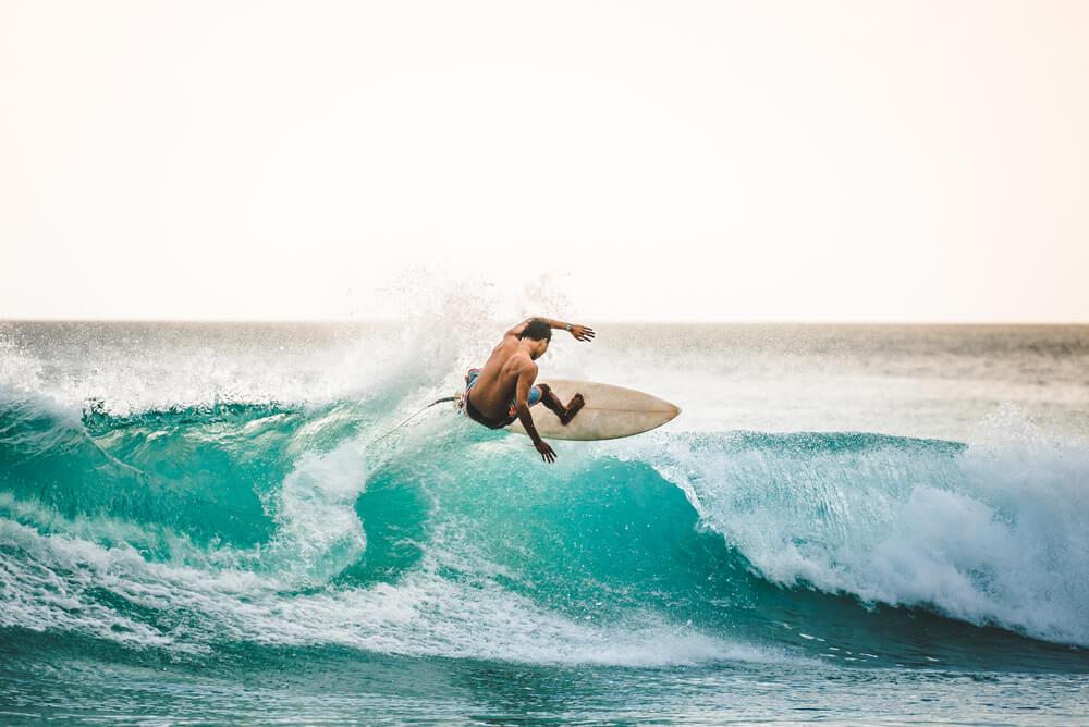 man surfing on holiday overseas