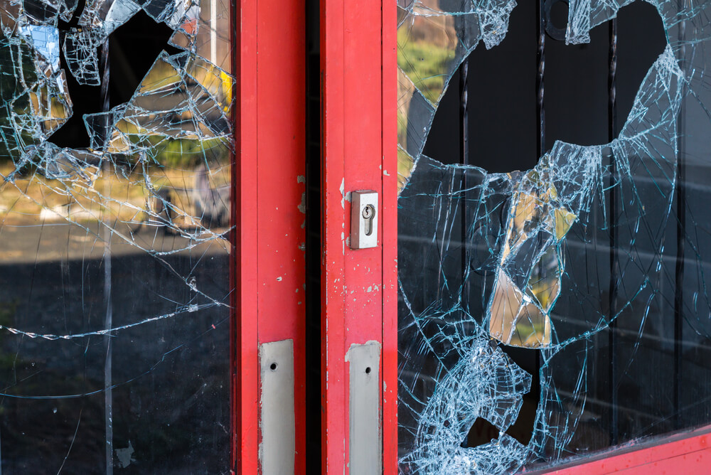Shop front with smashed glass