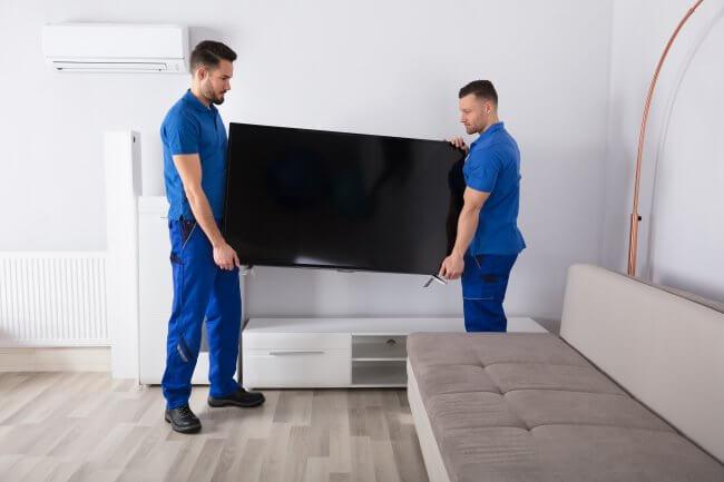men delivering tv
