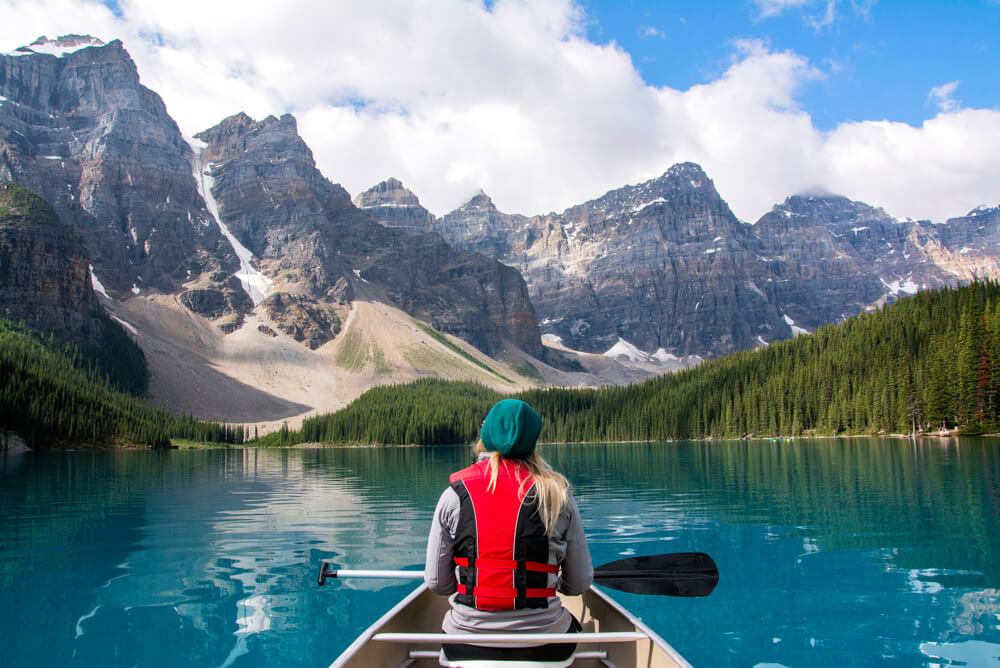 Woman kayaking at Moraine Lake Alberta Canada