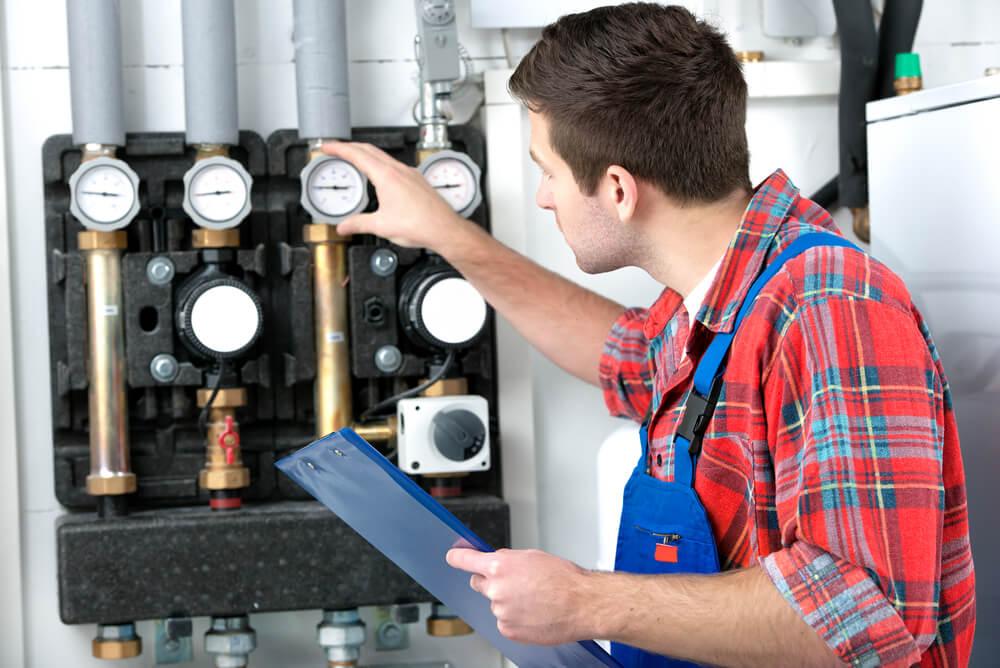 gas plumber checking meters