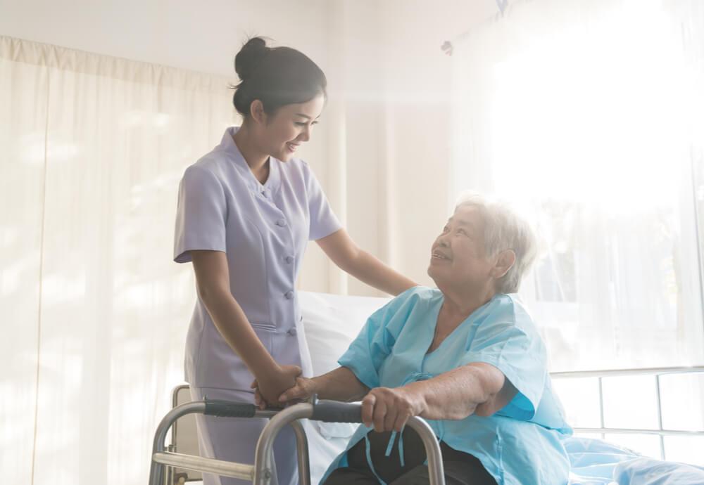 nurse helping female patient