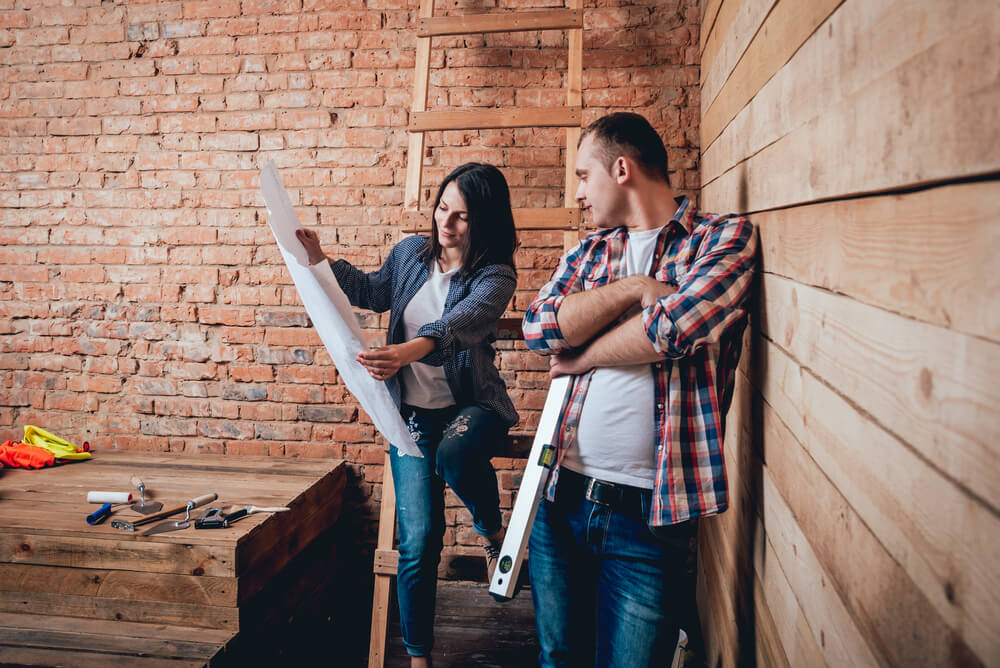 a couple looking at home renovation plans