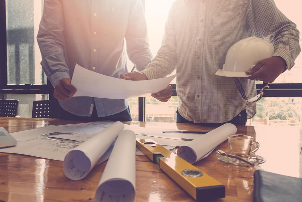 builders reviewing renovation plans