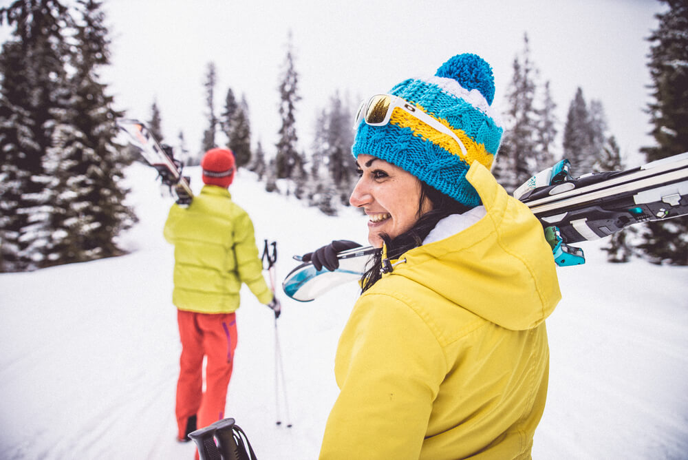 a couple on a ski trip in the snow