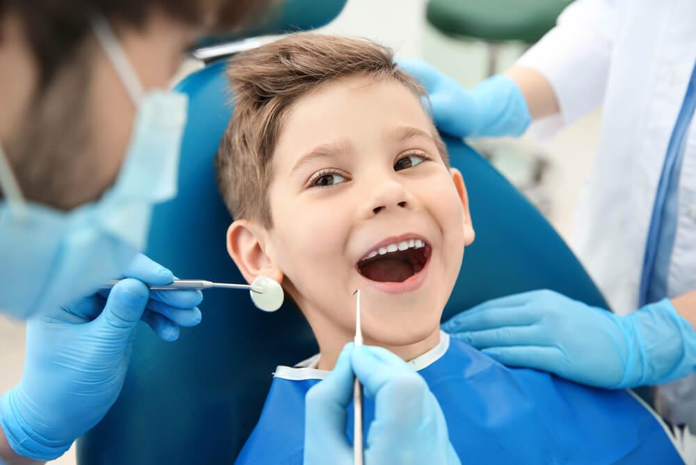 young boy receiving dental treatment through family extras cover