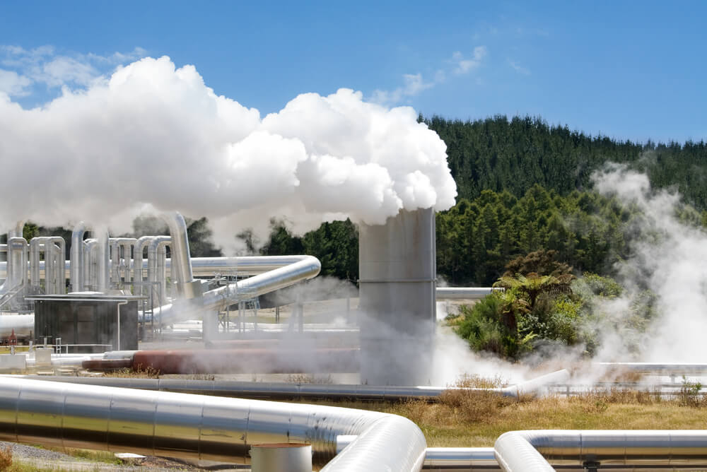 steam rising from a vent at a geothermal power plant